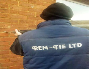 Wall Tie Replacement - Cutting out the corrosion to old tie - Rem-tie Ltd in North East, Newcastle, Durham, Sunderland, North Shields
